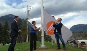 Proprietors at Fort Berens raise flag at grand opening
